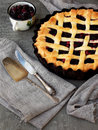 Traditional berries yeast pie tart on rustic wooden background. Homemade sweet cake. Baked pastry food. Top view. Space for text.