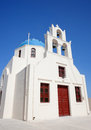 Traditional blue cupola in oia santorini church with town santorin greek islands greece Royalty Free Stock Images