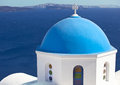 Traditional blue cupola in oia santorini church with at village island greece Royalty Free Stock Photo