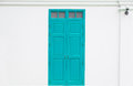 Traditional blue door wooden of an old on white wall Royalty Free Stock Photo