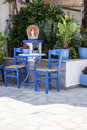 Traditional blue greek chairs in a backyard beautiful Royalty Free Stock Photography