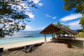 Traditional boat and bungalow on tropical beach local gili meno lombok indonesia Royalty Free Stock Image
