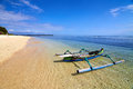 Traditional boat on tropical beach local gili meno lombok indonesia Stock Photo