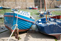 Traditional boats on beach one with for sale sign Royalty Free Stock Image