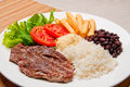 Traditional brazilian meal a dish rice black beans grilled beef and tomato and lettuce salad Stock Photography