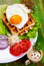 Traditional  breakfast. Fried eggs and tomatoes on a white plate Royalty Free Stock Photo