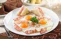 Traditional breakfast of scrambled eggs and sandwiches Royalty Free Stock Photo