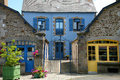 Traditional breton houses facade of with blue shutters france Royalty Free Stock Photo