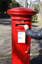 Traditional British red post box Royalty Free Stock Photo