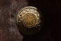 Traditional bronze door handle on a wooden door Royalty Free Stock Photo