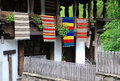 Traditional bulgarian woven fabrics on the balcony of the wooden house in etar village Stock Photos