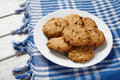 Traditional cereal oatmeal cookies with raisins and chocolate healthy sweet Royalty Free Stock Photo