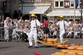 Traditional cheese market spectacle in alkmaar bearers run with the hand barrows with gouda at the the netherlands this large year Royalty Free Stock Photo