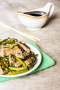 Traditional chinese dish with roasted pork, garlic, ginger and sesame seeds served with soy sauce