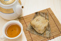 Traditional Chinese glutinous rice dumpling with cup of tea and teapot horizontal Royalty Free Stock Photo