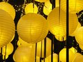 Traditional Chinese new year lantern or round ceiling lamp yellow. Yellow bright light. Royalty Free Stock Photo
