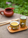 Traditional chinese oolong tea ceremony accessories tea cups an and pitcher on the stone table selective focus on cup Royalty Free Stock Images
