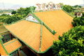 Traditional chinese roof of classical house with yellow glazed tiles in palace east asia building and green edge tile Stock Images