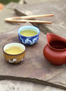 Traditional chinese tea ceremony accessories cups and pitcher on the stone table Stock Images
