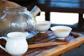 Traditional chinese tea ceremony accessories glass pot and cups leaves in boiling water in a selective focus on cup Stock Photos