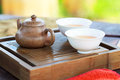 Traditional chinese tea ceremony accessories pot and pair on the table selective focus on pot Stock Image