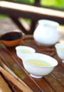 Traditional chinese tea ceremony accessories selective focus on cups and a strainer pumpkin cup Stock Photo