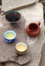 Traditional chinese tea ceremony accessories tea cups and pitch pitcher on the stone table selective focus on Royalty Free Stock Photo