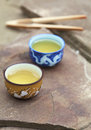 Traditional chinese tea ceremony accessories tea cups on the s stone table copy space selective focus first cup Royalty Free Stock Image