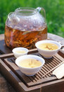 Traditional chinese tea ceremony accessories tea leaves in boil white kidney puer boiling water a glass pot selective focus Stock Photo