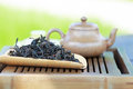 Traditional chinese tea ceremony accessories tea pot and feng h huang puer on the table selective focus Stock Image