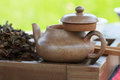Traditional chinese tea ceremony accessories tea pot on the te and broken feng huang puer table selective focus Royalty Free Stock Photos