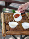 Traditional chinese tea ceremony accessories on the tea table s cups pouring selective focus Royalty Free Stock Image