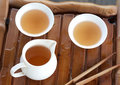 Traditional chinese tea ceremony accessories on the tea table s cups selective focus Royalty Free Stock Photo