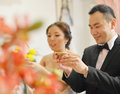 Traditional chinese wedding tea ceremony bride and groom focus on hand and teacup Stock Images