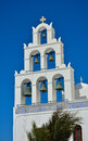 Traditional church with bells on santorini greece white against a blue sky oia Stock Images