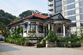 Traditional colonial house Singapore next to modern highrise building Royalty Free Stock Photo