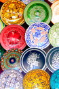 Traditional colorful moroccan faience pottery dishes in a typical ancient shop in the medina s souk of marrakech morocco Royalty Free Stock Photos