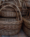 Traditional craft wicker baskets on wooden shelf detailed handicraft souvenir handmade basket handles closeup stock photos Royalty Free Stock Images