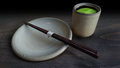 Traditional cup of green tea and blank plate with chopstick Royalty Free Stock Photo
