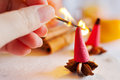 Traditional Czech christmas - smoking incense cones with star anise spice and apples Royalty Free Stock Photo