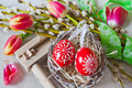 Traditional Czech easter decoration - regional wooden ratchet in Royalty Free Stock Photo