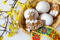 Traditional Czech easter decoration - white eggs in wicker nest Royalty Free Stock Photo