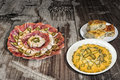 Russian Salad With Appetizer Savory Dish Meze And Spinach Cheese Pie Zeljanica Served On Old Weathered Cracked Garden Table Royalty Free Stock Photo