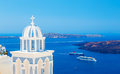 Traditional dome of the Church on background Caldera, cruise ship and sea Royalty Free Stock Photo