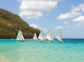 Traditional double ended sailboats competing in the bequia easter regatta hand crafted wooden dinghies participating an annual Stock Photography