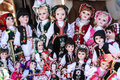 Traditional dressed dolls on sale in raffia basket Royalty Free Stock Photo