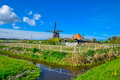 Traditional dutch windmill in famous Kinderdijk, The Netherlands Royalty Free Stock Photo
