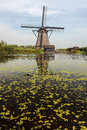 A traditional Dutch windmill in Kinderdijk Holland Royalty Free Stock Photo