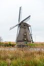 Traditional dutch windmill in winter kinderdijk netherlands Royalty Free Stock Images