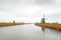 Traditional dutch windmill in winter kinderdijk netherlands Stock Photos